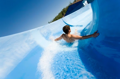 Man going down water slide